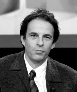 Photo du docteur Pascal Guigui, spécialiste de la greffe de cheveux